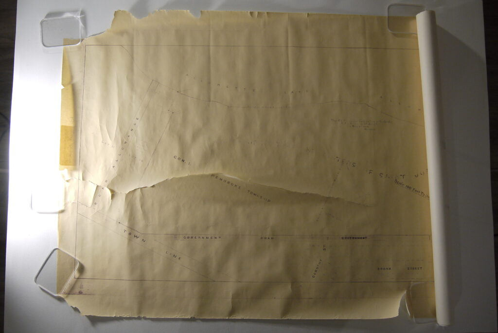 Rolled and torn map before conservation treatment