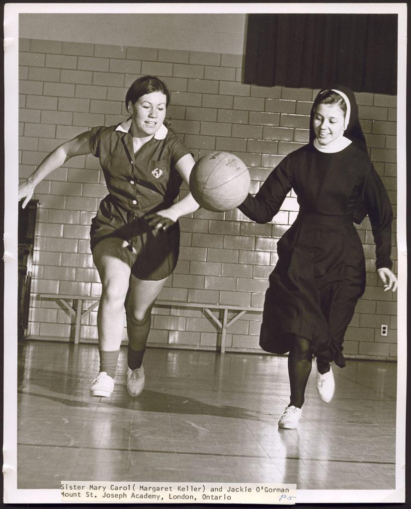 Sister and student playing basketball