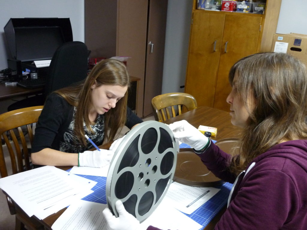 Students making film condition report