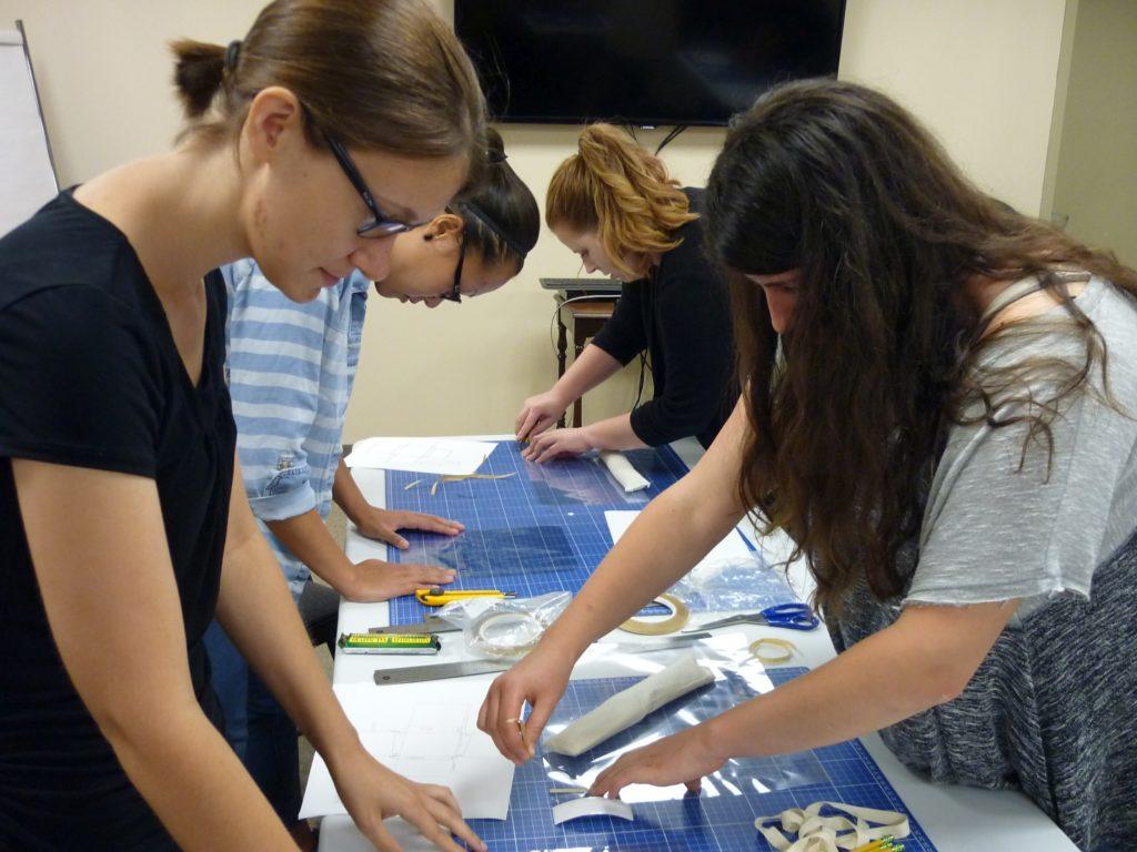 Students making mylar enclosures