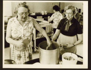 Sister cooking at soup kitchen